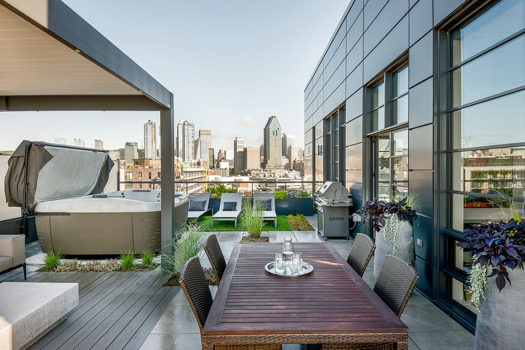 Green roof terrace of penthouse with view of downtown Montreal