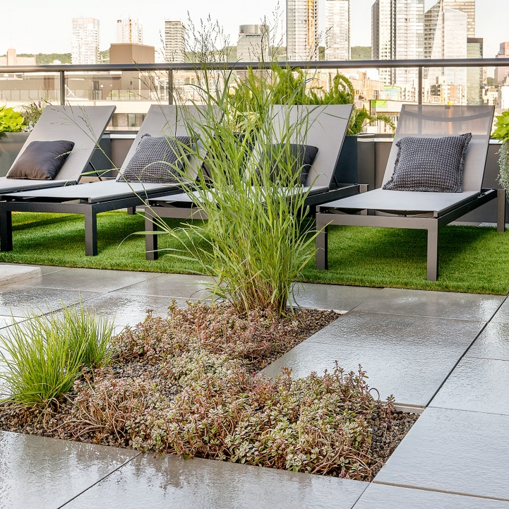 Green roof terrace with plants and integrated relaxation area